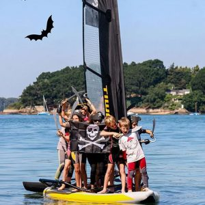 Kids Sailing a Tiwal Inflatable Sailboat for Halloween