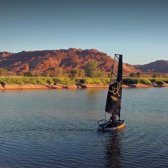 Inflatable sailboat Tiwal 3 sailing in Namibian dramatic landscapes