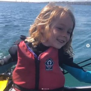 Little girl sailing Tiwal 3 inflatable sailing dinghy