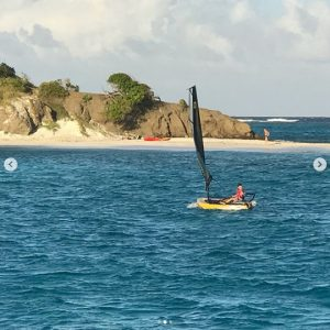 A kid sailing an inflatable sailing dinghy Tiwal 3 in Tobago Kay