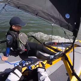 Sailing Tiwal 3 inflatable sailboat with a kid in San Francisco Bay