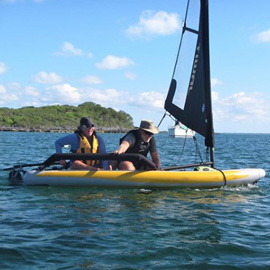 Couple having fun on a Tiwal 3 inflatable sailing boat