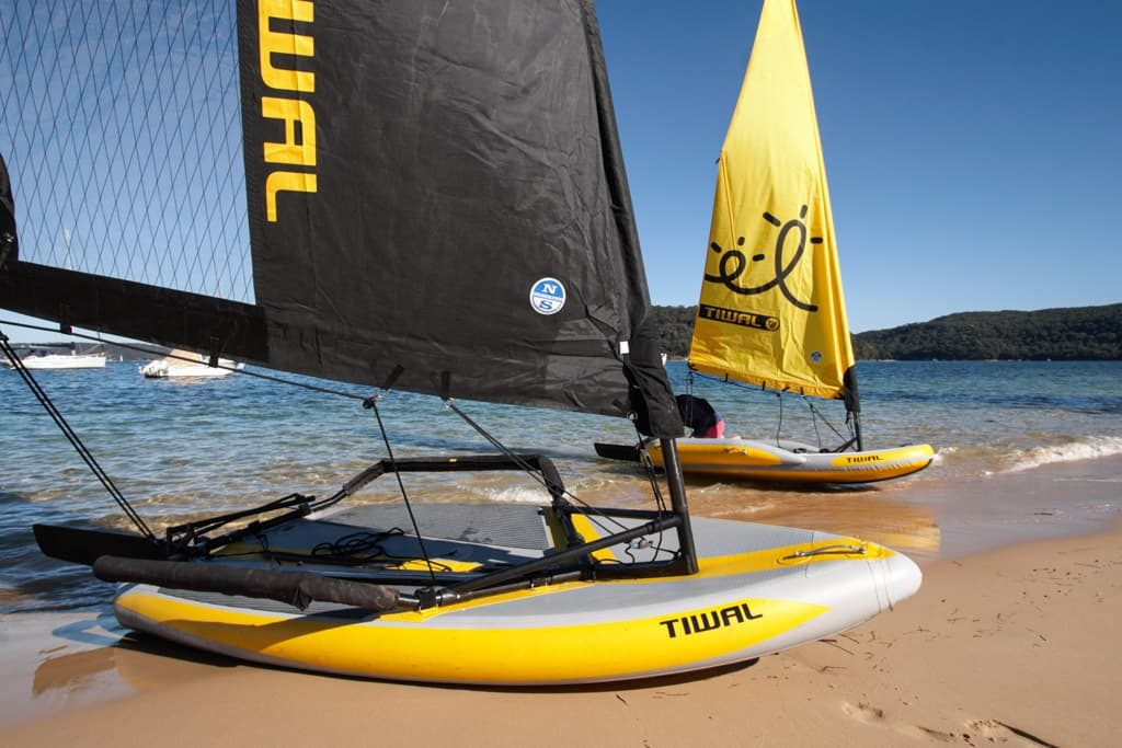 Both Tiwal 2 and 3 Sailboats beached in Pittwater
