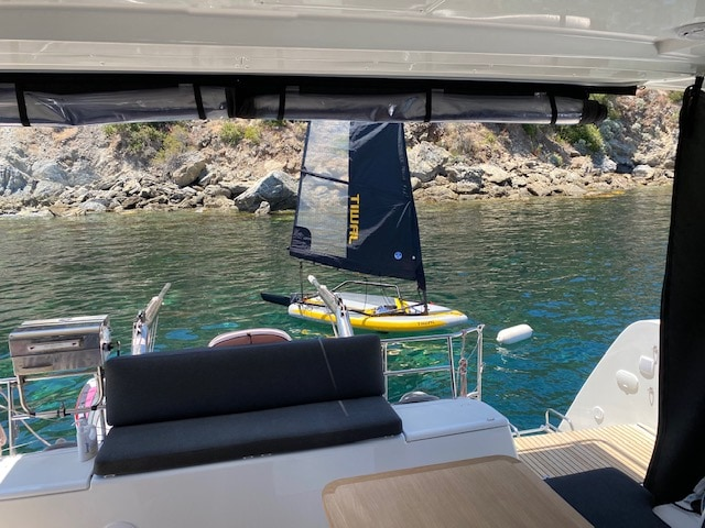 Tiwal 3 small sailboat at moorings